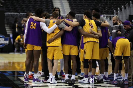 LSU huddles before practicing for their Sweet 16 game against Michigan State, Thursday, March 28, 2019 at Capital One Arena in Washington, D.C.