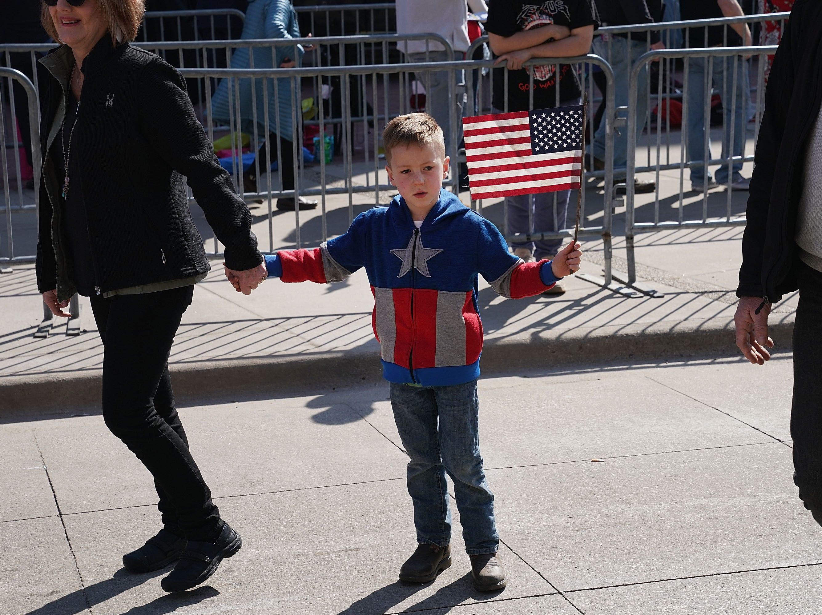 A young boy pauses to watch anti-Trump demonstrators protest outside of the Van Andel Arena where President Donald Trump was scheduled to hold a rally on March 28, 2019 in Grand Rapids, Michigan. Grand Rapids was the final city Trump visited during his 2016 campaign.