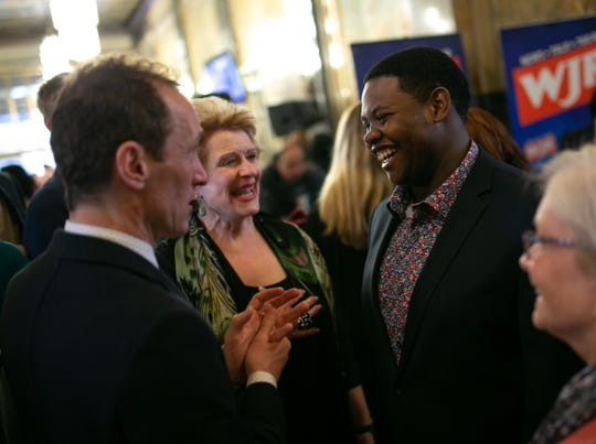 """Stephan Wilson, right, of Flint is introduced to """"Hamilton"""" lead producer Jeffrey Seller, left, by U.S. Sen. Debbie Stabenow, center, during Thursday's event."""