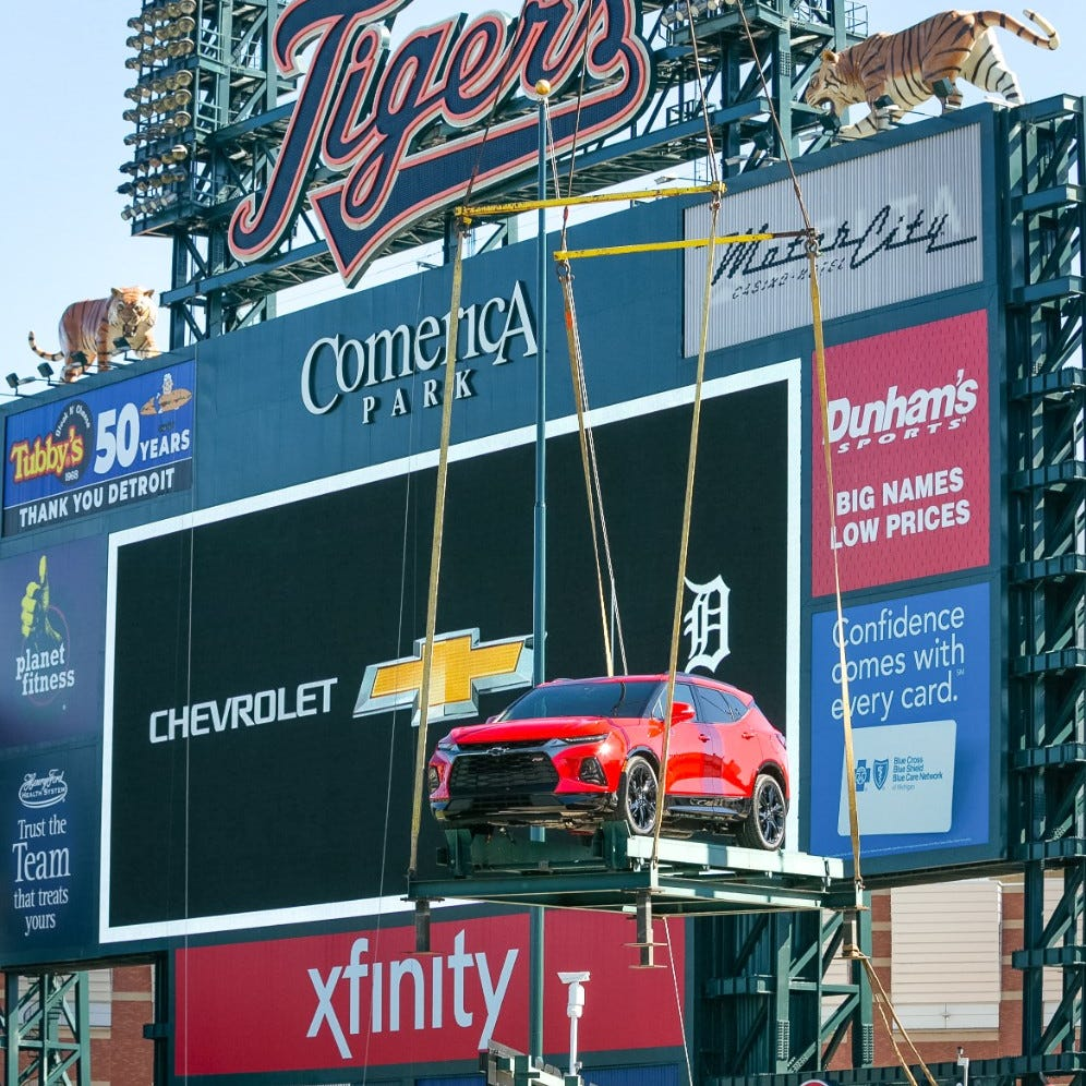 A red 2019 Chevrolet Blazer RS is lowered by a crane into place on a centerfield platform in the Chevrolet Fountain at Comerica Park on Tuesday, March 26, 2019.