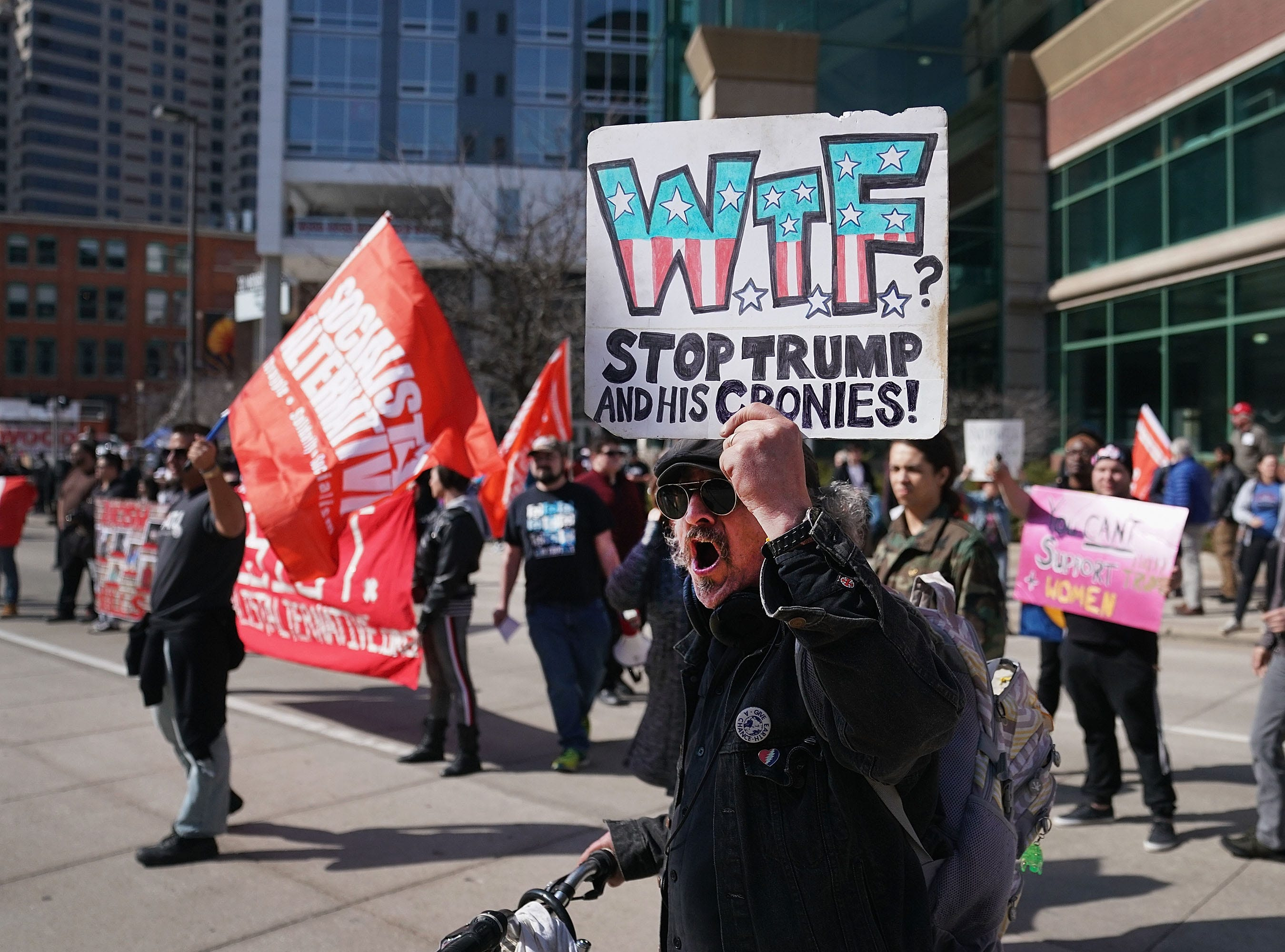 Anti-Trump demonstrators protest across from the Van Andel Arena where President Donald Trump was scheduled to hold a rally on March 28, 2019 in Grand Rapids, Michigan. Grand Rapids was the final city Trump visited during his 2016 campaign.