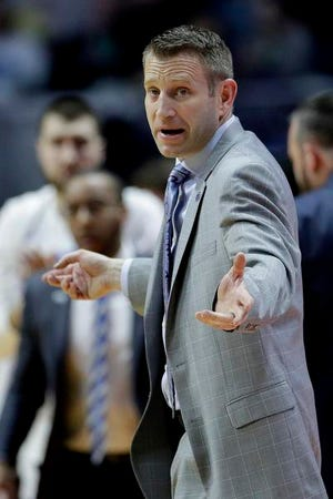 Nate Oats, who was the boys basketball coach at Romulus High School, originally went to Buffalo to be the top assistant for Bobby Hurley.