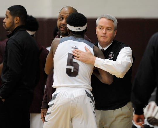 Pat Donnelly congratulates Cassius Winston after a U-D Jesuit game against East English Village in 2014.
