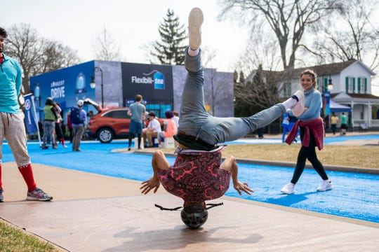 Artists, and actors perform for the media during a reveal of the 2020 Ford Escape at Greenfield Village, in Dearborn.