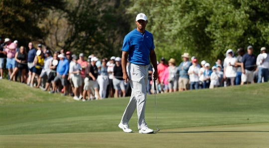 Tiger Woods prepares to putt on the 16th hole during round-robin play at the Dell Match Play Championship.