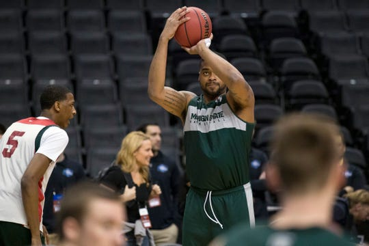 Michigan State's forward Nick Ward shoots during practice Thursday.