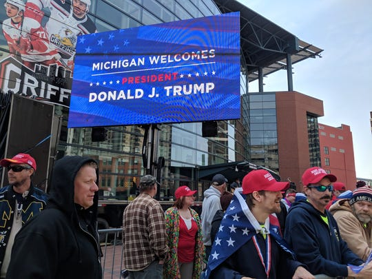 Trump supporters line up outside the Van Andel Arena in downtown Detroit.
