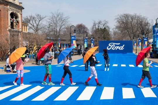 Actors, performers and artists participate in the reveal of the 2020 Ford Escape during a live performance at Greenfield Village.