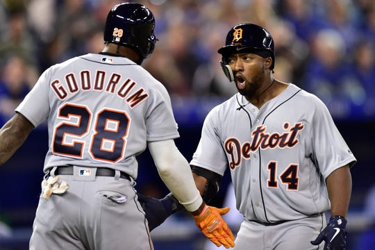 Niko Goodrum greets Christin Stewart at home after Stewart's two-run home run in the 10th.
