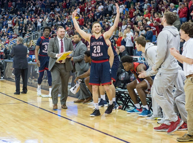 University of Southern Indiana's Alex Stein (20) celebrates after defeating the West Texas A&M Buffaloes during the NCAA Men's Division II Quarterfinals at Ford Center in Evansville, Ind., Wednesday, March 27, 2019. USI defeated West Texas A&M, 94-84.