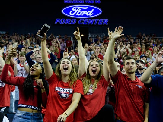 Elexis Coleman, from left, Casey Cepicky and Alyssa Yochum, all University of Southern Indiana volleyball players, cheer alongside other student fans for the men's basketball team during the NCAA Men's Division II Quarterfinals against the West Texas A&M Buffs at Ford Center in Evansville, Ind., Wednesday, March 27, 2019. The Screaming Eagles defeated the Buffs, 94-84, to advance to Thursday's Final Four matchup.