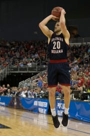 University of Southern Indiana's Alex Stein (20) takes a three-point shot during the University of Southern Indiana Screaming Eagles vs West Texas A&M Buffaloes game of the NCAA Men's Division II Elite 8 Basketball Tournament at the Ford Center in Evansville, Ind. Wednesday, March 27, 2019.