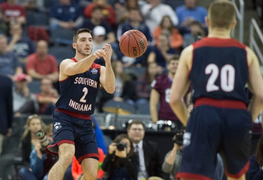 University of Southern Indiana's Jacob Norman (2) passes the ball to University of Southern Indiana's Alex Stein (20) during the NCAA Men's Division II Quarterfinals at Ford Center in Evansville, Ind., Wednesday, March 27, 2019. USI defeated West Texas A&M, 94-84.