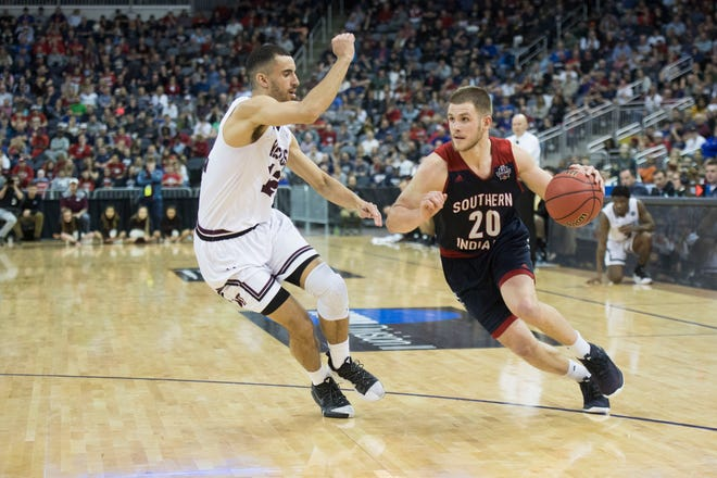 Alex Stein (20) drives to the basket in USI's 94-84 victory over West Texas A&M in the NCAA Division II quarterfinals on March 27, 2019 at Ford Center.