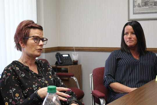 Sandusky County Department of Job and Family Services supervisor Tami Ward, left, and JFS director Melanie Allen discuss trauma experienced as social workers.