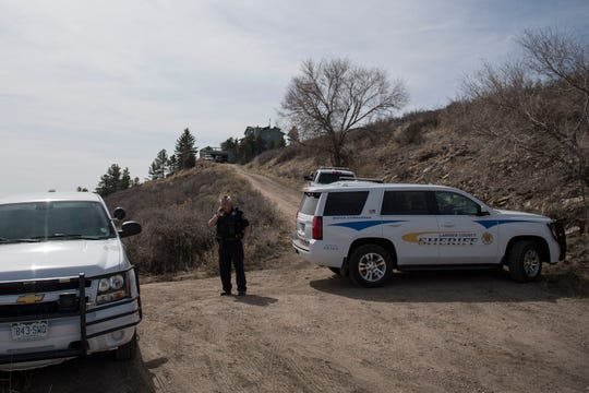 Larimer County Sheriff's Department's Lt. Robert Cook stands in the long dirt driveway of a residence where a body was found in a steep and difficult to access area behind the home after conducting a welfare check on a resident this morning, on Thursday, March 28, 2019, on the 3000 block of Centennial Drive, on the East side of Horsetooth Reservoir in Larimer County, Colo.