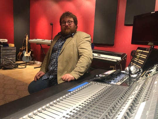 Julian Sundby mans the soundboard at Hero Song's new The Fort Studios in Fort Myers.