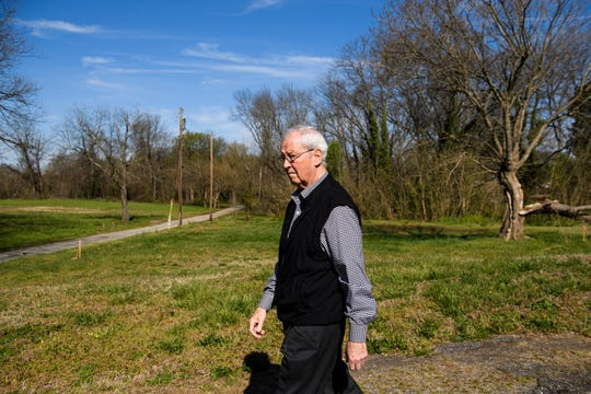 Wayne Trotter walks along his property along the Unity Park project Thursday, March 28, 2019. Trotter is in the process of donating his land to the city to build affordable housing as part of the park project.