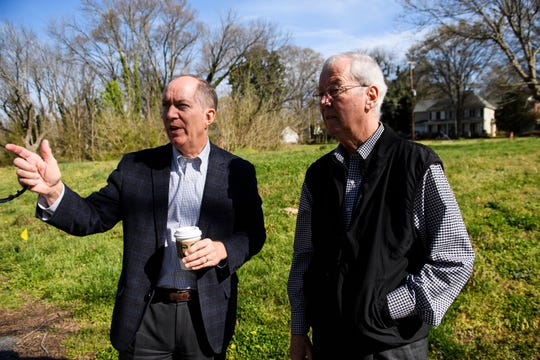 Wayne Trotter speaks with mayor Knox White at his property along the Unity Park project site Thursday, March 28, 2019. Trotter is in the process of donating his land to the city to build affordable housing as part of the park project.