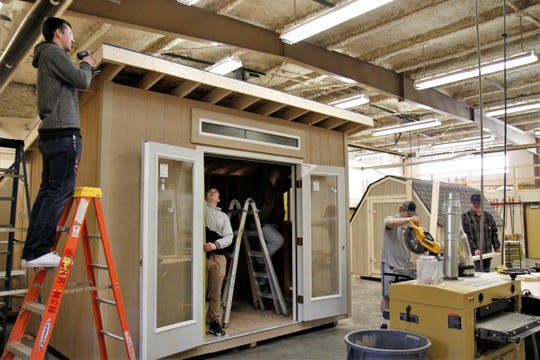 High School House students working on the studio shed on Friday, March 22