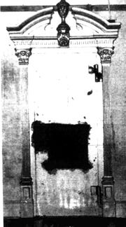 The door to the vault of the abandoned bank in Smith Mills after a hole was cut in it to free 14-year-old Vance Tapp, who had gotten trapped there for three hours on April 6, 1994.