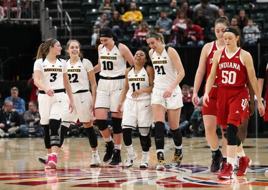 """They call this their """"victory formation."""" Iowa players Makenzie Meyer (3), Kathleen Doyle (22), Megan Gustafson (10), Tania Davis (11) and Hannah Stewart (21) prepare to shoot clinching free throws against Indiana in the quarterfinals of the Big Ten Tournament."""