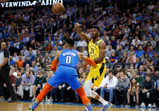 Mar 27, 2019; Oklahoma City, OK, USA; Indiana Pacers forward Thaddeus Young (21) passes the ball over Oklahoma City Thunder guard Russell Westbrook (0) during the first quarter at Chesapeake Energy Arena. Mandatory Credit: Alonzo Adams-USA TODAY Sports