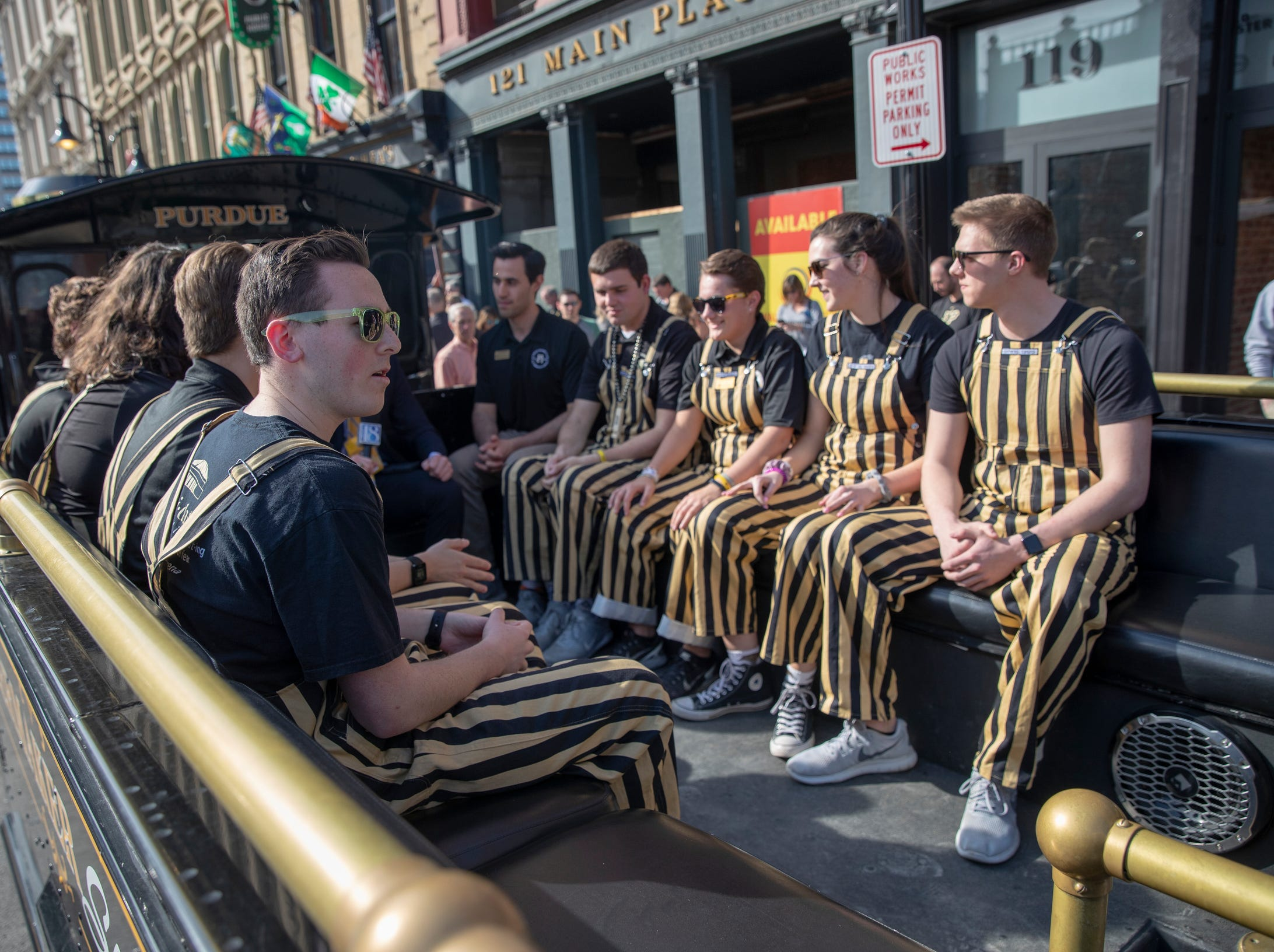 Purdue students sit in the Boilermaker Special, the mascot of Purdue, sits on the street near the NCAA Division 1 Men's Basketball 'Sweet Sixteen' game site, KFC Yum Center, Louisville, Thursday, March 28, 2019.