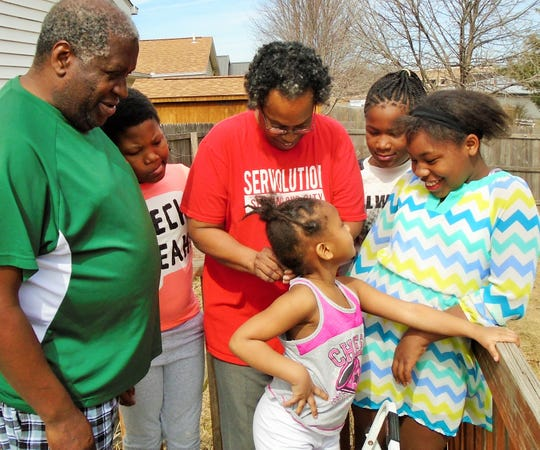 Some members of the Skinner family gathered recently on the back deck of their North Liberty home. From left, they are William, Sa'Ron, Juanita, Sa'Renity and Brionta, with four-year-old London in front.