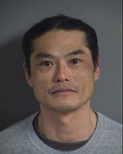 Cho Kantaphone, 43, is accused of control of firearm by a felon charges.