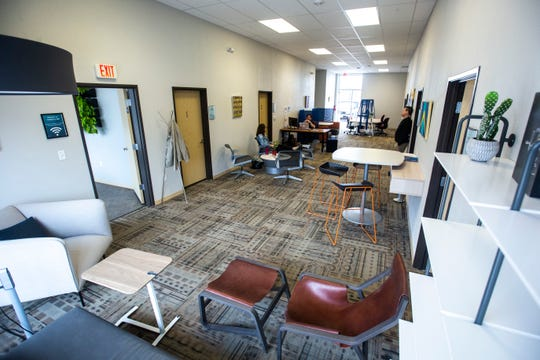 Members work on Thursday, March 28, 2019, inside CoWork @ 808 along 5th Street in Coralville, Iowa.