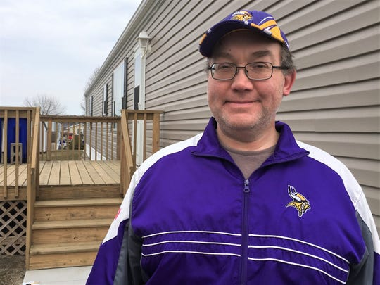 Scott Boerhave said that while he can afford a rent increase, he worries about others in the neighborhood. He stands outside his home on March 28, 2019.