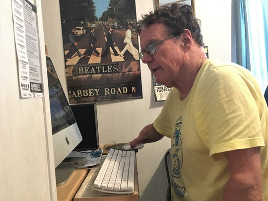 Don Lund works on a sports column at his desk in Golfview Mobile Home Park on March 28, 2019.