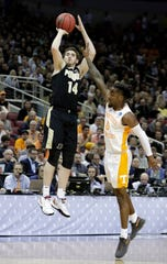 Purdue's Ryan Cline (14) shoots over Tennessee's Jordan Bone (0) during the first half of a men's NCAA Tournament college basketball South Regional semifinal game, Thursday, March 28, 2019, in Louisville, Ky. (