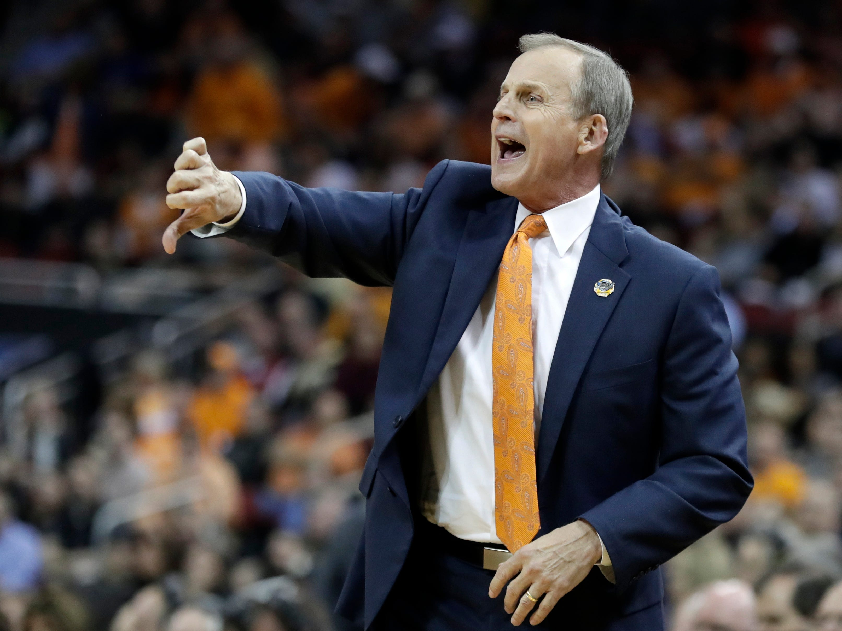 Tennessee head coach Rick Barnes calls a play during the first half of a men's NCAA Tournament college basketball South Regional semifinal game against Purdue, Thursday, March 28, 2019, in Louisville, Ky.