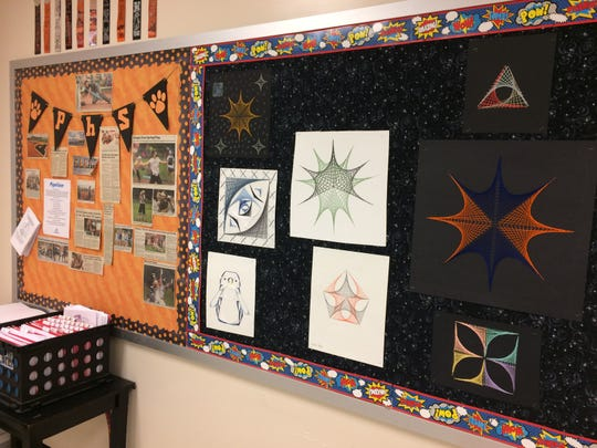 "Whether it's the artistic design of geometric shapes (right) or a bulletin board filled with newspaper clippings of students, Alice Carson tries to make her classroom interesting. ""You have to become part of the community they've built here at Powell."""