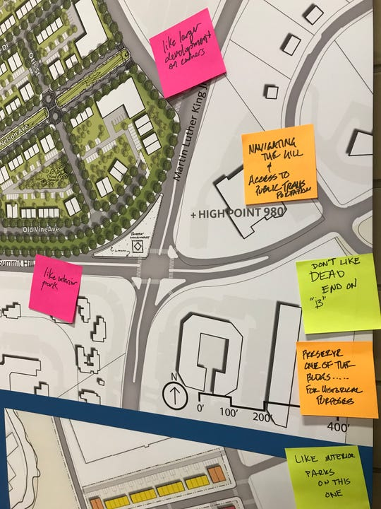 Notes on public preferences and suggestions hang on a concept plan for redeveloping the Austin Homes site.