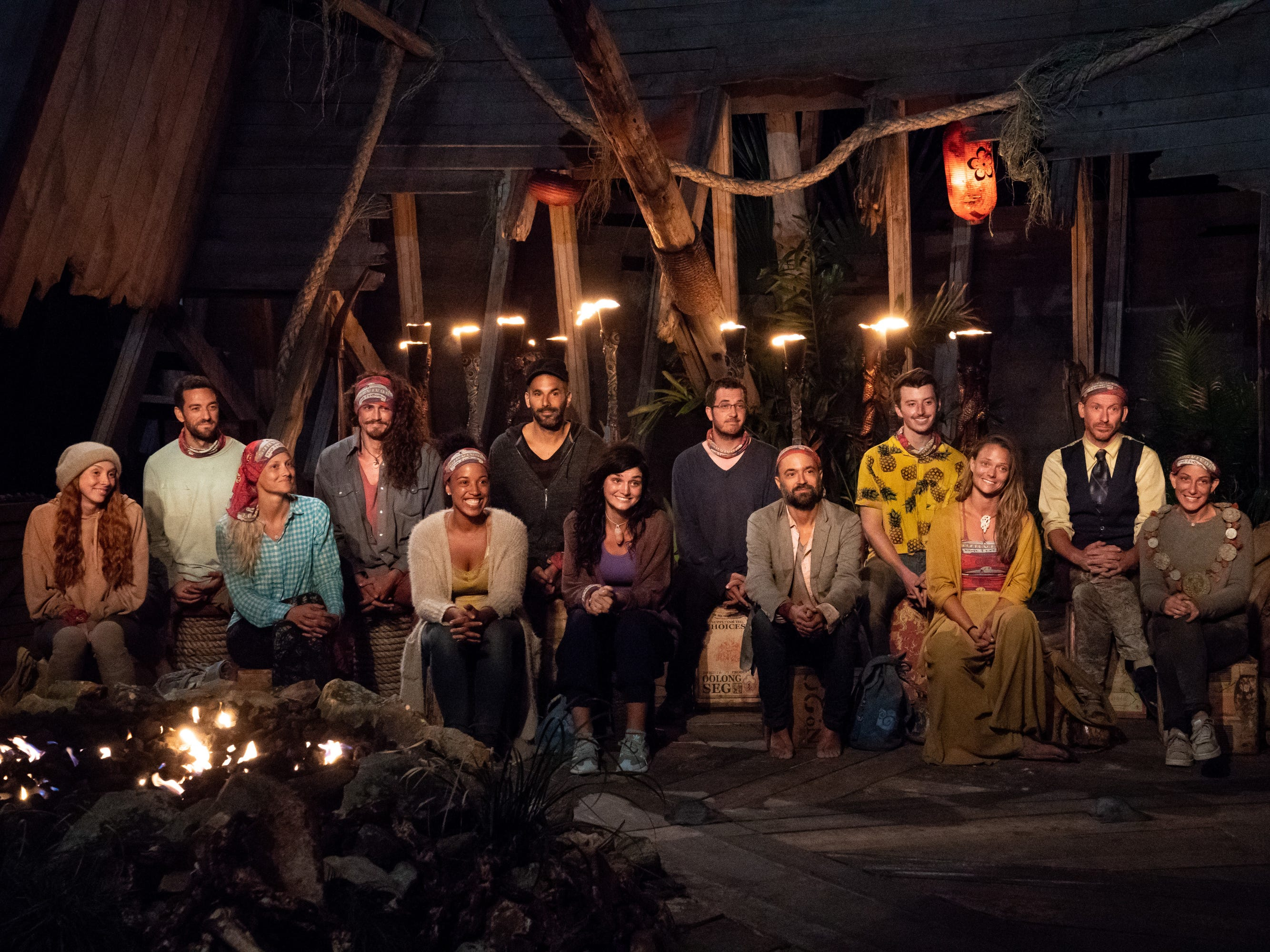 "From left are Victoria Baamonde, Eric Hafemann, Kelly Wentworth, Joe Anglim, Julia Carter, Dan ""Wardog"" Dasilva, Lauren O\'Connell, Rick Devens, David Wright, Gavin Whitson, Aurora McCreary, Ron Clark and Julie Rosenberg at Tribal Council on ""Survivor: Edge of Extinction."""