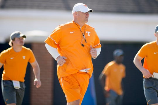 Tennessee quarterbacks coach Chris Weinke runs down the field during Tennessee spring football practice at Haslam Field in Knoxville, Tennessee on Thursday, March 28, 2019.