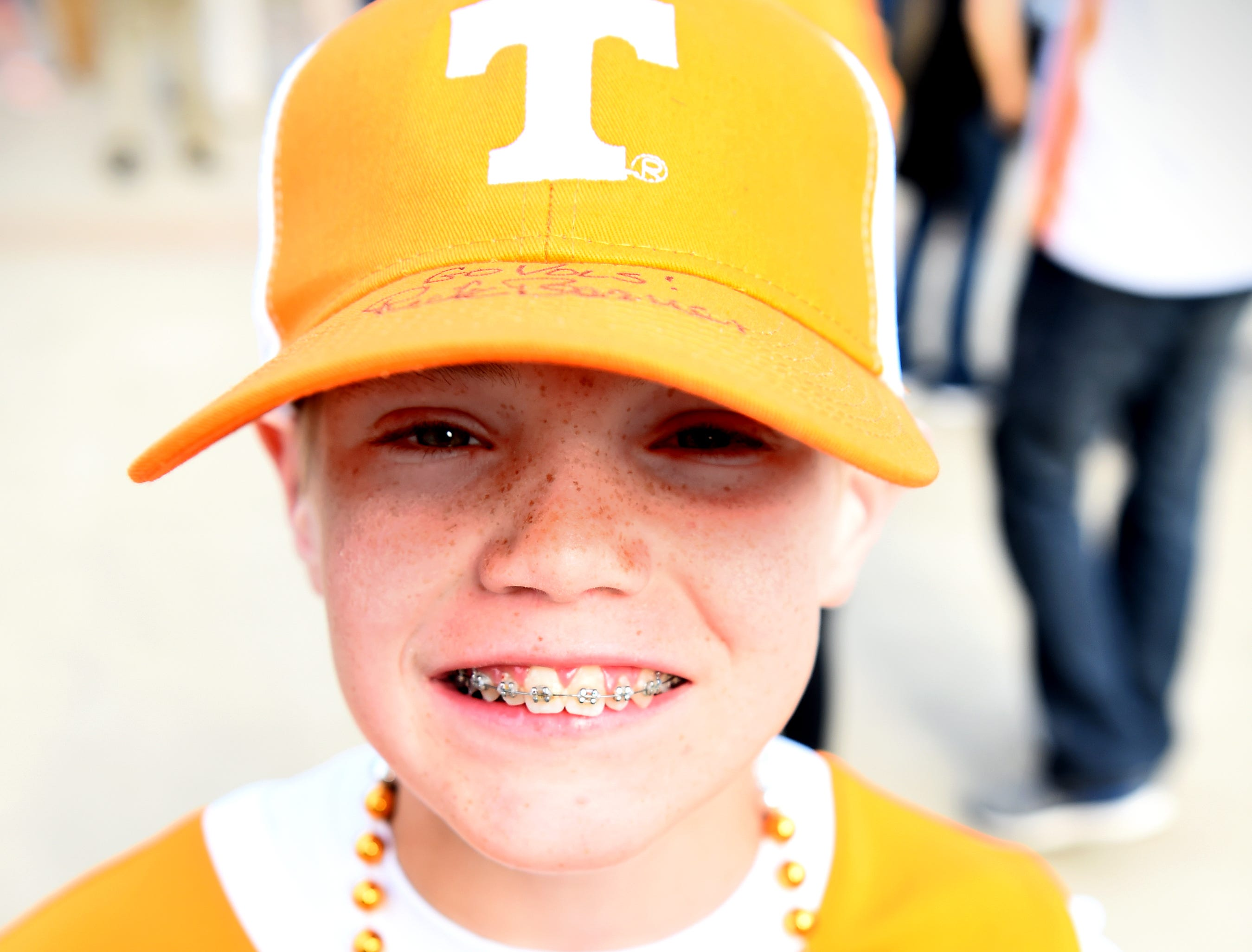 Micah Bennett of Knoxville sports a Tennessee head coach Rick Barnes-signed cap before the Tennessee Volunteers' basketball Sweet 16 game against the Purdue Boilermakers in the NCAA Tournament held at the KFC Yum! Center in Louisville, Ky., on Thursday, March 28, 2019.