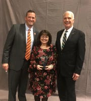 Alice Carson, Knox County Schools' Teacher of the Year, is flanked by Powell High School principal Dr. Chad Smith and superintendent Dr. Bob Thomas. March 2019