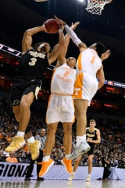 Purdue Boilermakers guard Carsen Edwards (3) goes up for a shot as Tennessee Volunteers forward Grant Williams (2) and guard Lamonte Turner (1) defend during the first half in the semifinals of the south regional of the 2019 NCAA Tournament at KFC Yum Center.