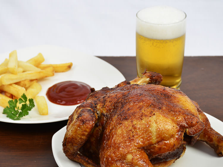 A whole, half or quarter pan fried chicken can be ordered solo or with any number of side dishes.