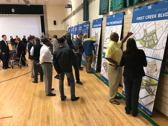 Austin Homes residents and other members of the public discuss redevelopment plans Thursday, March 27, 2019, with Knoxville's Community Development Corp. and Gensler officials.