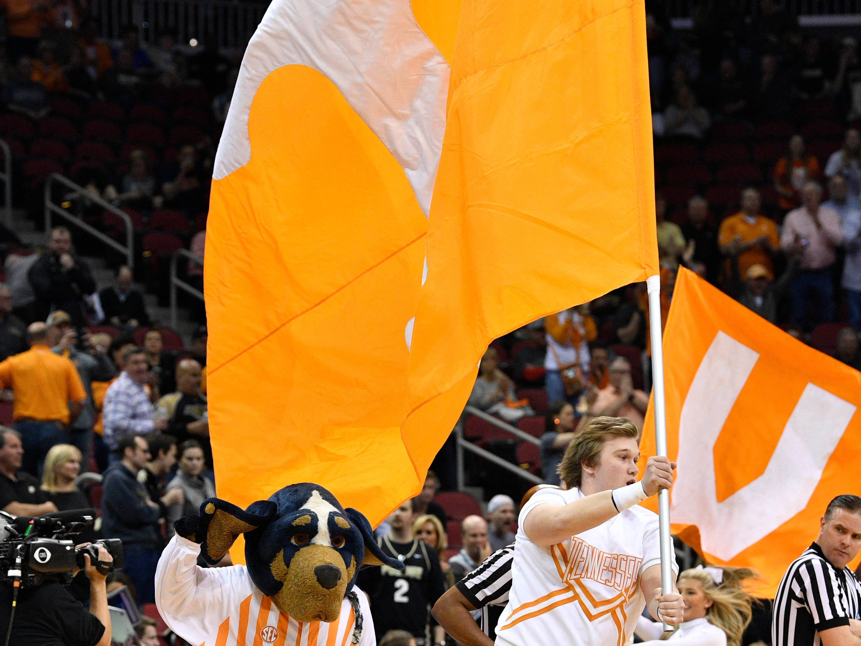 Mar 28, 2019; Louisville, KY, United States; Tennessee Volunteers cheerleaders and mascot perform before the game against the Purdue Boilermakers in the semifinals of the south regional of the 2019 NCAA Tournament at KFC Yum Center. Mandatory Credit: Jamie Rhodes-USA TODAY Sports