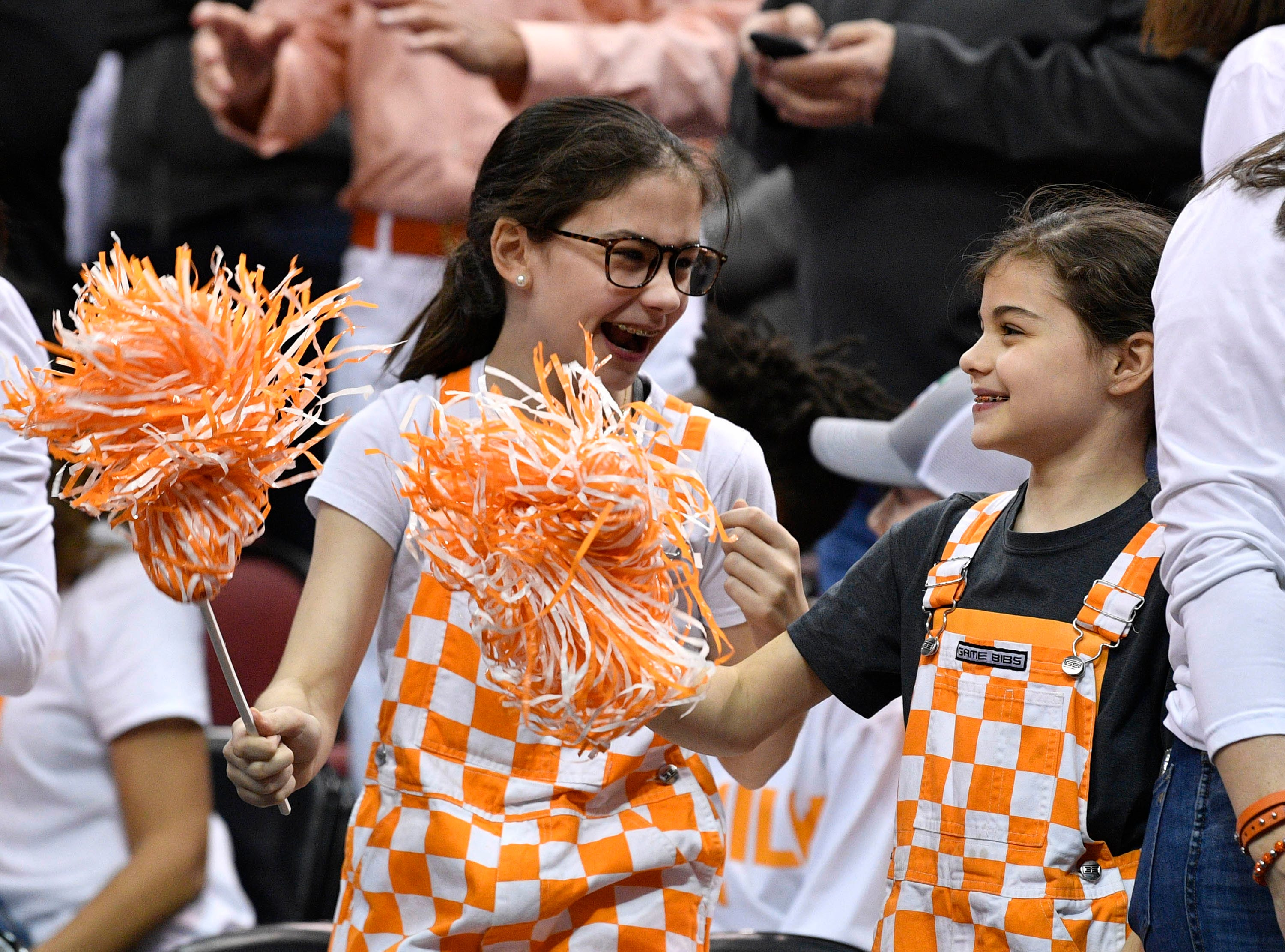 Mar 28, 2019; Louisville, KY, United States; Tennessee Volunteers fans cheer before the game against the Purdue Boilermakers in the semifinals of the south regional of the 2019 NCAA Tournament at KFC Yum Center. Mandatory Credit: Jamie Rhodes-USA TODAY Sports