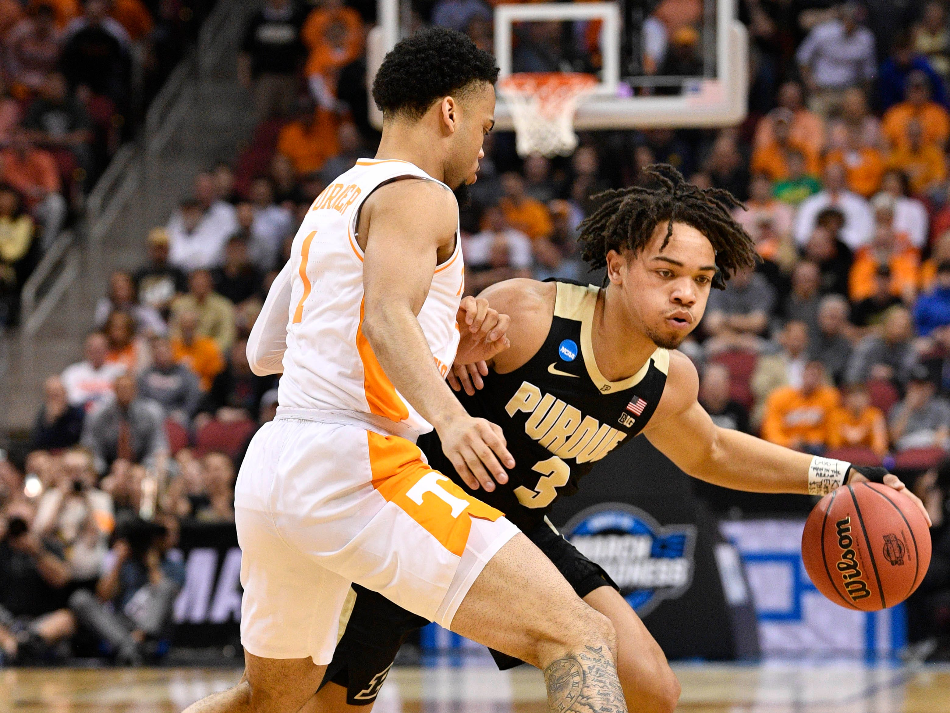 Mar 28, 2019; Louisville, KY, United States; Purdue Boilermakers guard Carsen Edwards (3) works around Tennessee Volunteers guard Lamonte Turner (1) during the first half in the semifinals of the south regional of the 2019 NCAA Tournament at KFC Yum Center. Mandatory Credit: Jamie Rhodes-USA TODAY Sports