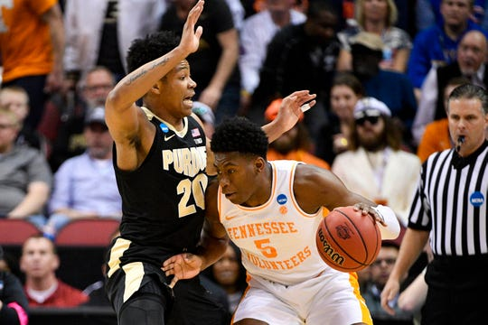 Mar 28, 2019; Louisville, KY, United States; Tennessee Volunteers guard Admiral Schofield (5) works around the defense of Purdue Boilermakers guard Nojel Eastern (20) during the first half in the semifinals of the south regional of the 2019 NCAA Tournament at KFC Yum Center. Mandatory Credit: Jamie Rhodes-USA TODAY Sports