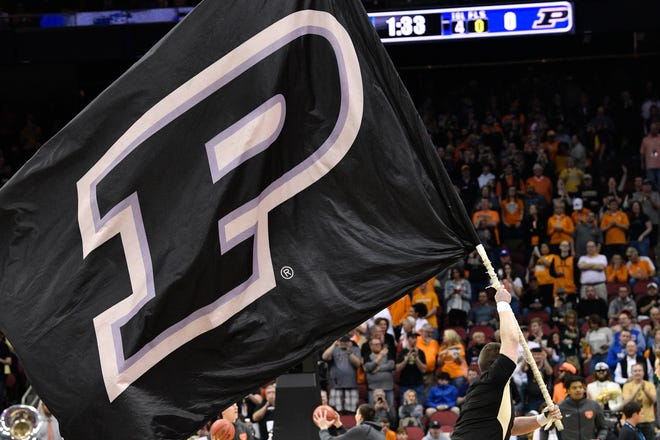 Mar 28, 2019; Louisville, KY, United States; Purdue Boilermakers cheerleader flies a flag before the game against the Tennessee Volunteers in the semifinals of the south regional of the 2019 NCAA Tournament at KFC Yum Center. Mandatory Credit: Jamie Rhodes-USA TODAY Sports