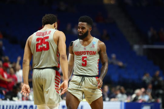 Houston Cougars guard Corey Davis Jr. (5) celebrates with Galen Robinson Jr. (25) after their game against Ohio State in the second round of the 2019 NCAA Tournament.